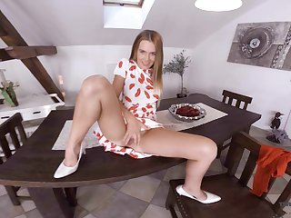 Sex-hungry blonde Timea Bella is toying pussy on transmitted to table