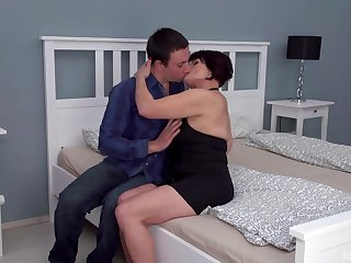 Dark-haired mature slut Attilane beds a much younger mendicant