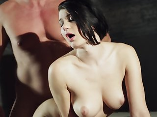A menacing haired pale girl with natural tits is fucked from behind