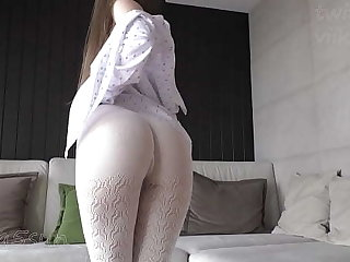 white pantyhose exceeding naked elastic ass of a young dame