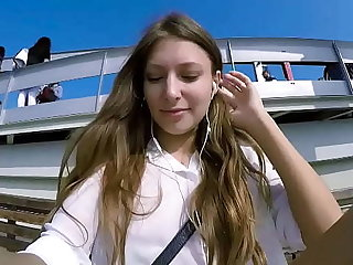 Talia Mint plays in public on every side remote control toy over make an issue of phone on every side fan