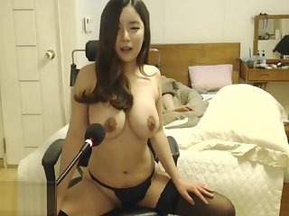 Korean beauty in stockings plays with her bulky tits