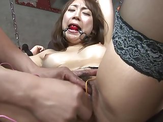 Hot sex consequent gilr gets will not hear of clit teased hither toys in a dungeon