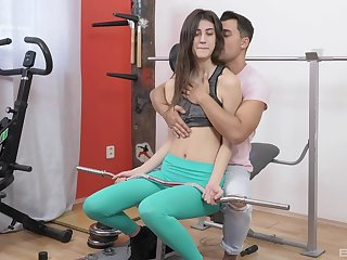 Fit chick Kerry Ill-lit teased by her trainer with an increment of penetrated