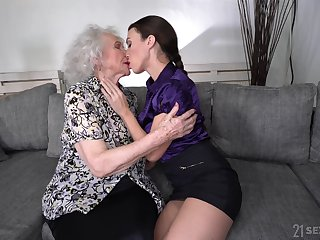 Young lesbian Tiffany Ungentlemanly is licking pussy of good looking granny
